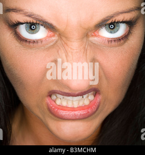 Woman's face, snarling, close-up, portrait - Stock Photo