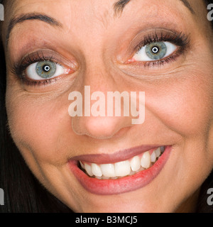 Young woman laughing, portrait, close-up - Stock Photo