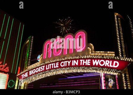 The brightly lit sign that arches over Virginia Avenue in downtown Reno, Nevada USA reads 'The Biggest Little City - Stock Photo