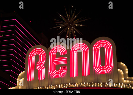 The brightly lit sign that arches over Virginia Avenue in downtown Reno, Nevada USA (reads 'Reno') - Stock Photo