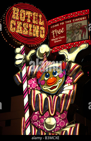 A very colorful clown sign at night in front of 'Circus Circus' in Reno, Nevada, USA. - Stock Photo