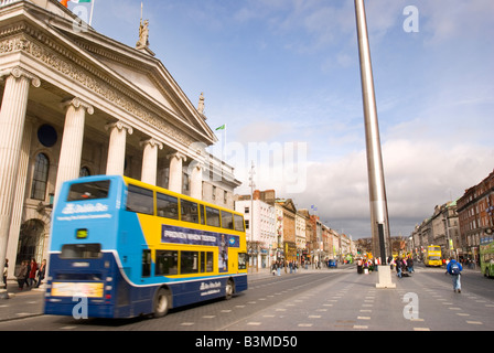 A public transport bus drives past the General Post Office building towards the Dublin Spire, O'Connell Street, - Stock Photo