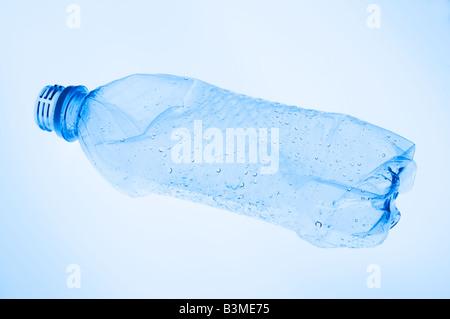 a flattened empty clear plastic water bottle - Stock Photo