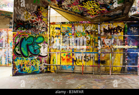 Graffiti in an urban concrete setting - Stock Photo