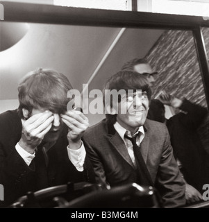 JOHN LENNON at left and George Harrison at London's Madame Tussauds waxworks in  March 1964 - Stock Photo