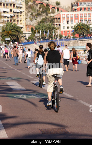 France Cote d Azur Nice The Promenade des Angais along the beach front is popular with strollers bike riders and - Stock Photo