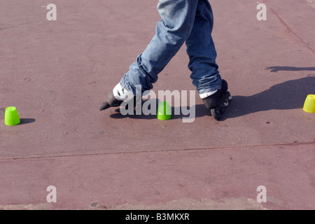 France Cote d Azur Nice Roller blader performing tricks on Promenade des Anglais in Nice - Stock Photo