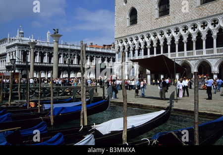 Italy Venice Gondolas tied up along the Grand Canal beside the Palazza Ducale - Stock Photo