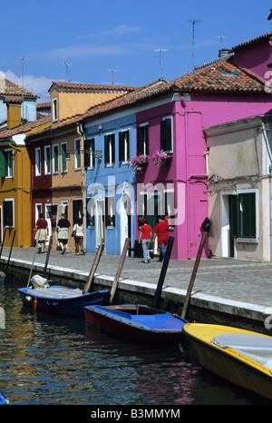 Italy Venice Colourful houses line a canal on the island of Burano near Venice - Stock Photo