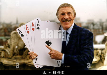 Bruce Forsyth TV Presenter Holding playing cards which are used on his hit tv show Play your cards right - Stock Photo