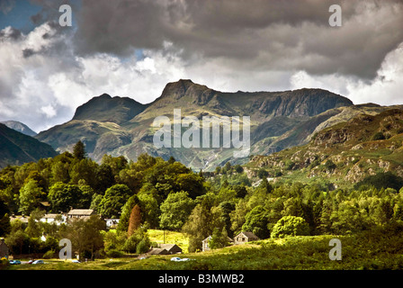 The Langdale pikes in the great Langdale valley with the village of Elterwater in the foreground. - Stock Photo