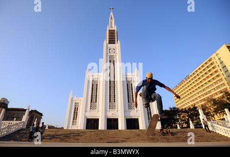 Docas the skater jumping into the air outside the Catholic cathedral of Nossa Senhora da Conceicao in Maputo, Mozambique. - Stock Photo