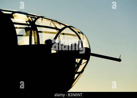 silhouette nose gun World War II military aircraft - Stock Photo