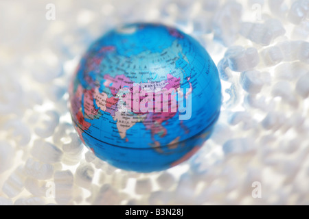 globe in protective packaging - Stock Photo