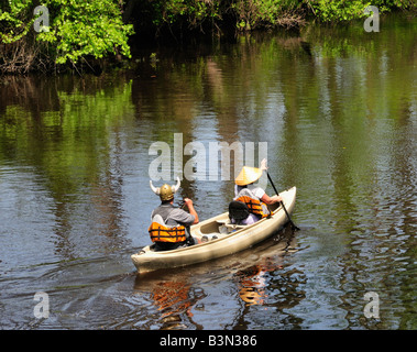 A couple with interesting hats on the Dismal Swamp Canal during the May 3, 2008 Paddle for the Border - Stock Photo