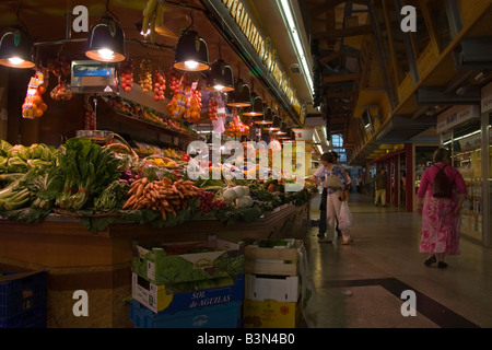 Fresh fruit and vegetables on sale at an indoor market - Stock Photo
