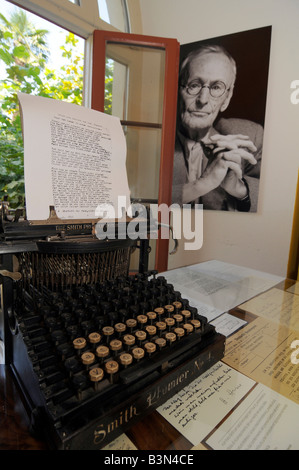 Portrait of German writer Herman Hesse near an old typewriter in a museum reconstituting his working room in Switzerland. - Stock Photo