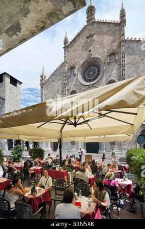 Cafe in front of the cathedral (the Duomo), Piazza del Duomo, Como, Lake Como, Lombardy, Italy - Stock Photo
