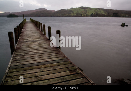 Long exposure of a jetty on Coniston Water, Lake District, UK - Stock Photo