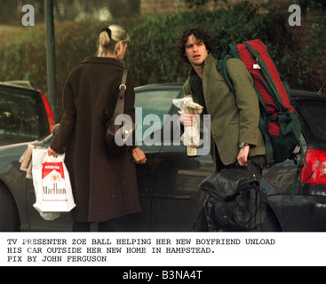 Zoe Ball TV presenter helping her new boyfriend Hal Voger unload his car outside her new home in Hampstead - Stock Photo