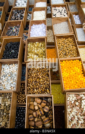 France, Paris, Market stall with buttons - Stock Photo
