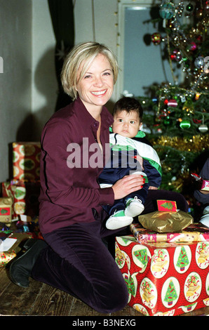 Mariella Frostrup TV Presenter Film Critic December 1997 Handing out christmas presents at the Refugee council s - Stock Photo