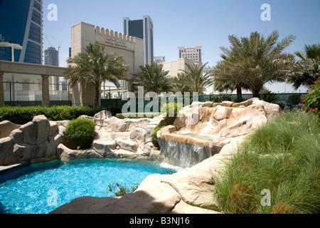 Four Seasons Hotel 5 Five Star Luxury Doha Qatar Exterior Swimming Pool Middle East Arabian Gulf - Stock Photo
