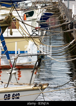 Boats tied up to a Pier in Geelong Australia. - Stock Photo