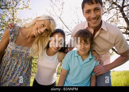 Germany, Baden Württemberg, Tübingen, Family portrait, smiling, close-up - Stock Photo