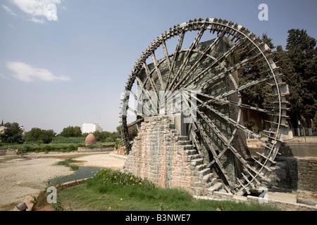 Giant wooden waterwheels aka Norias, on the Orontes River, Hama, Syria - Stock Photo