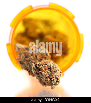 Dried medical cannabis buds in a prescription bottle - Stock Photo