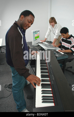 Group playing composing arranging and recording music in a studio - Stock Photo