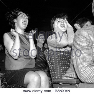 Pop Group The Beatles in Exeter November 1963 Excited school girls fans greet their idols - Stock Photo