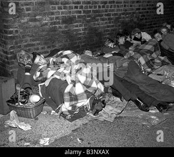 Pop Group The Beatles November 1963 Night shots of fans a sleep queuing at Newcastle Upon Tyne to see their idols - Stock Photo