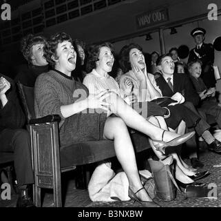 Pop Group The Beatles November 1963 Excited girls screaming for their idols durin the live gig in East Ham - Stock Photo