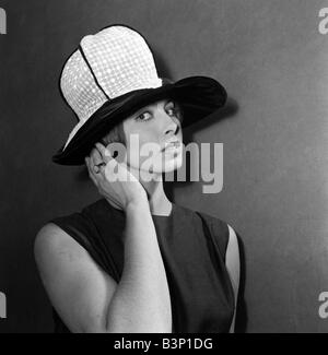 Clothing Fashion Hats January 1964 A hat by L Haarup called Florentine white embroidered organdie crown and black - Stock Photo