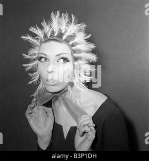 Clothing Fashion Hats January 1964 A Reed Crawford tulle helmet made of a burnt heron feathers Model Lois James - Stock Photo