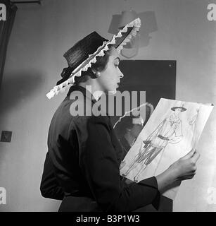 Daily Mirror fashion Editor Ailsa Garland looking at coronation designs wearing her own Coronation hat Wearing a - Stock Photo