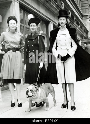 Clothing Fashions Women 1940s dresses Woman wearing Double breasted naval coat epaulettes Nelson walking a British Bulldog