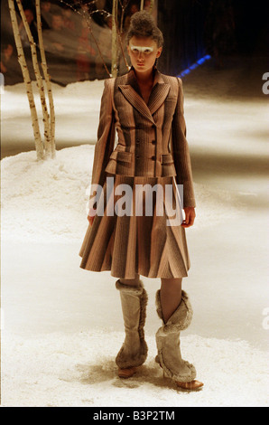 Alexander McQueen autumn winter collection February 1999 Wearing an asymetrically striped coat with skirt and boots - Stock Photo