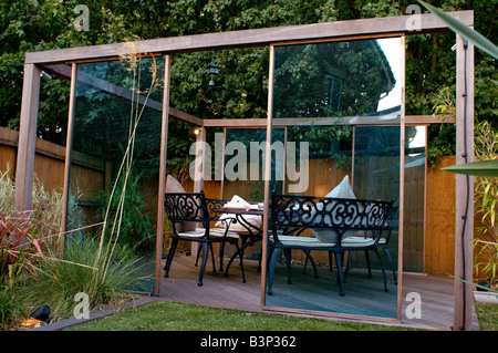 Outdoor Dining Set Under Gazebo In Modern Landscaped Garden   Stock Photo