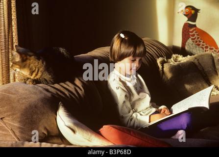 Child reading book Monroe Oregon - Stock Photo