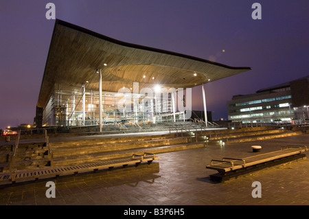 National Assembly of Wales government Senedd building Cardiff Bay UK night time, designed by architect Richard Rogers - Stock Photo