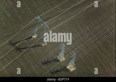 aerial above electrical powerlines California central valley - Stock Photo