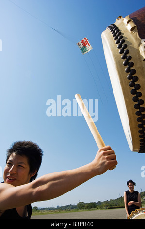 Japan, Kanagawa prefecture, Sagamihara near Tokyo, Taiko drumming group Otako age giant kite flying festival - Stock Photo