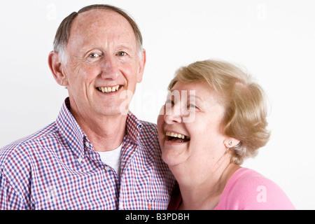 Happy embracing senior couple portrait - Stock Photo