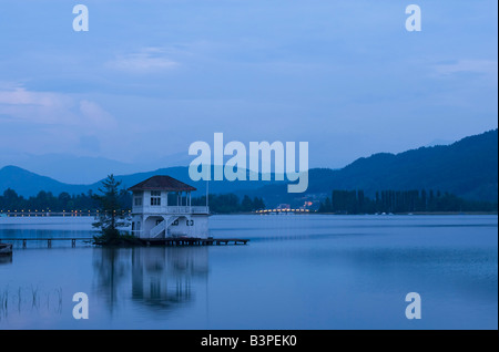 Bath house and boat house on Lake Woerthersee near Poertschach, Carinthia, Austria, Europe - Stock Photo