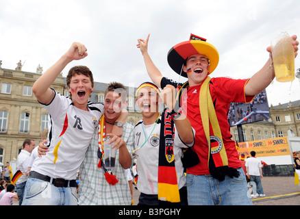 Fans of the German national soccer team celebrating on Schlossplatz Square, Baden-Wuerttemberg, Germany, Europe - Stock Photo