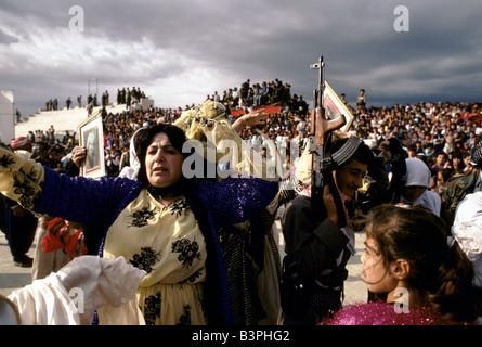 JUBILANT WOMAN AMONGST THE CROWD SCENE AT RALLY FOR MASOUD BARZANI HELD AT THE FOOTBALL STADIUM IN DAHUK, OCTOBER - Stock Photo