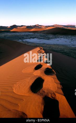 Tracks in the sand, Sossusvlei, Namib-Naukluft National Park, Namibia, Africa - Stock Photo
